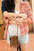 stock photo of lesbian  - Cropped image of hugging lesbian young couple - JPG