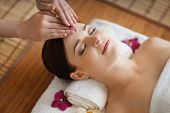 Young, beautiful and healthy woman in spa salon. Traditional oriental massage therapy and beauty tre poster