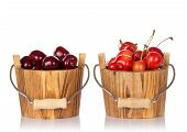picture of cherry  - Bucket with red sweet cherries and a bucket with pink sweet cherries isolated on white - JPG