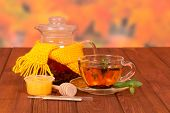 picture of gunfighter  - Teapot tied with yellow scarf and a cup of tea - JPG
