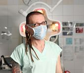 pic of icu  - Portrait of male nurse ICU with tattoo and dreadlocks on emergency room - JPG