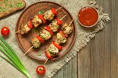 stock photo of turkey dinner  - Traditional delicious turkey kebab skewer barbecue meat with tomatoes and sauce on clay dish - JPG