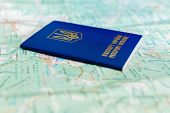 image of passport cover  - an image of Ukrainian passport on a the background of the tourist map - JPG
