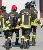 picture of stretcher  - Four brave Firefighters carry a fellow firefighter with the medical stretcher - JPG
