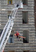 picture of fireman  - fearless fireman during an exercise carries the stretcher with the climbing rope - JPG