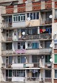 picture of overpopulation  - Facade of the shabby apartment house in Bulgaria - JPG