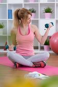 stock photo of bicep  - Fit muscular woman working on biceps with dumbbell - JPG