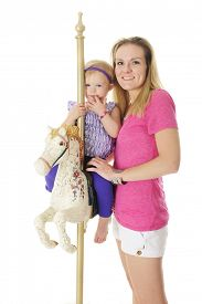pic of carousel horse  - A happy mom standing by her adorable 2 - JPG