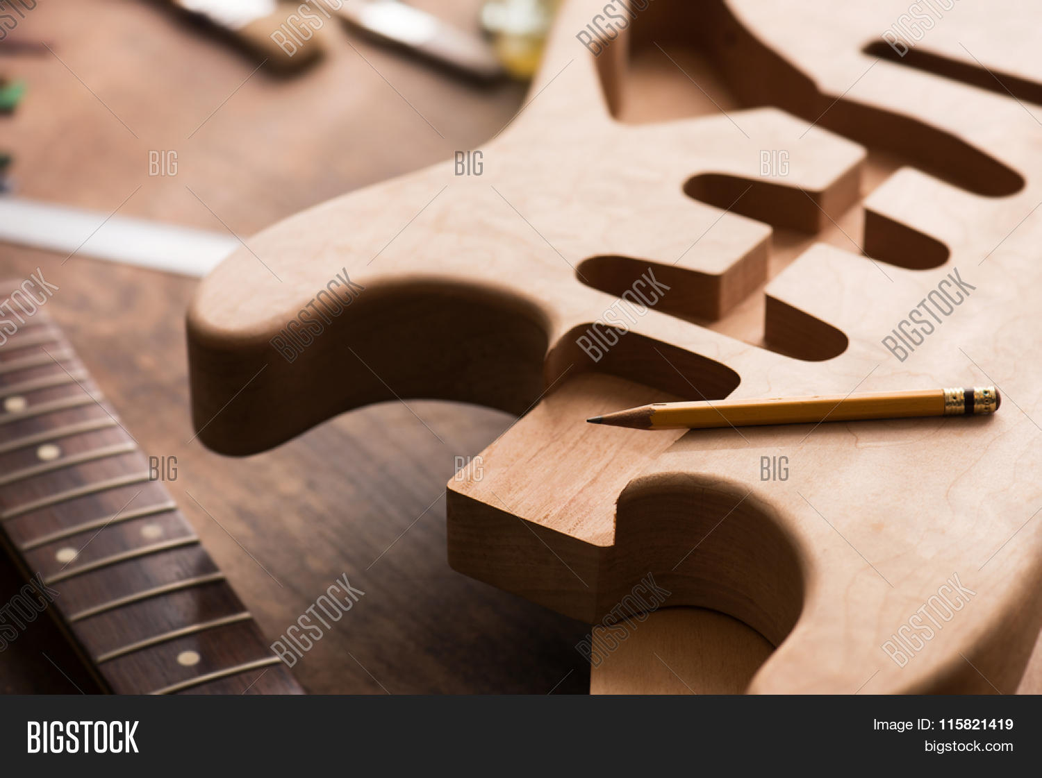 Electric guitar making. Guitar work shop. Unfinished solidbody ...