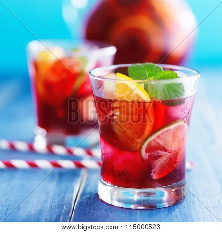 ice cold sangria with fruits and mint shot with selective focus