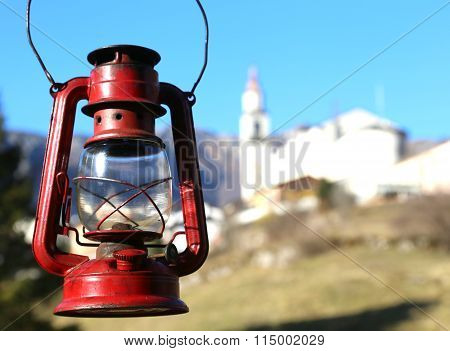 Vintage Red Lantern Near The Small Village Amid The Mountains