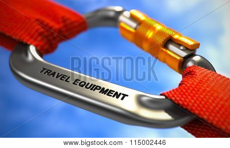 Travel Equipment on Chrome Carabiner between Red Ropes.