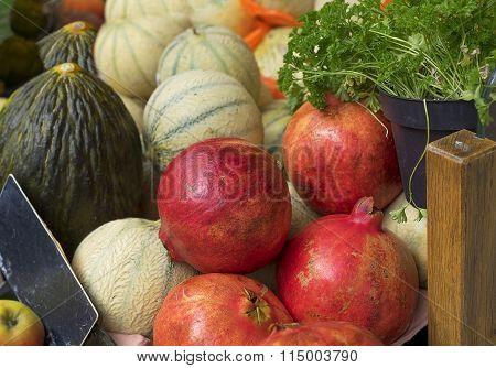 Fresh Produce With Pomegranates, Cantaloupe, Parsley