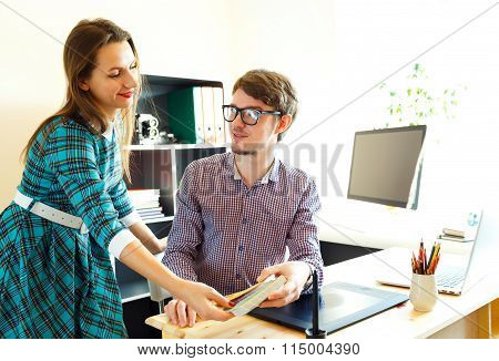 Young Woman And Man Working From Home - Modern Business Concept