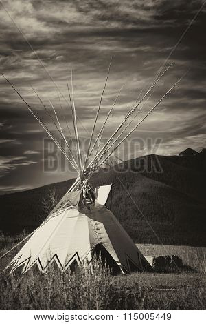 Tepee on the plains of Alberta with an antique plate effect.