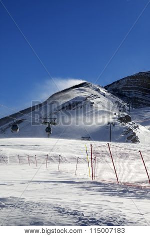 Gondola Lift On Ski Resort At Windy Sun Day