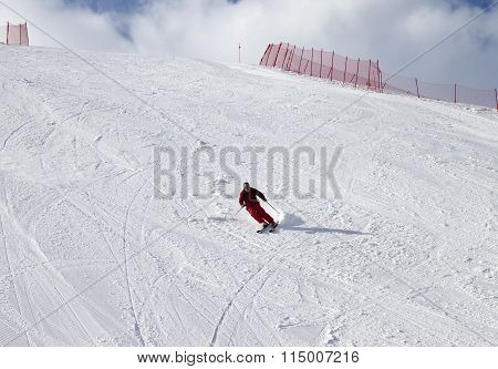 Skier On Ski Slope At Sun Day