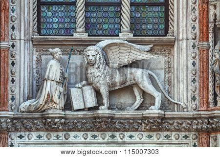 Winged Lion On Facade Of The Bell Tower At San Marco Square In Venice