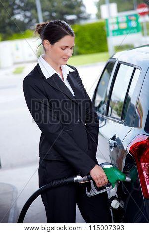 Business Woman Filling Car