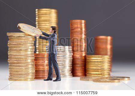 Business Man Saving Money