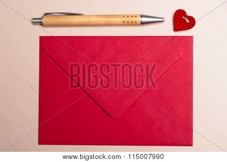 Red Envelope Heart And Pen On Table