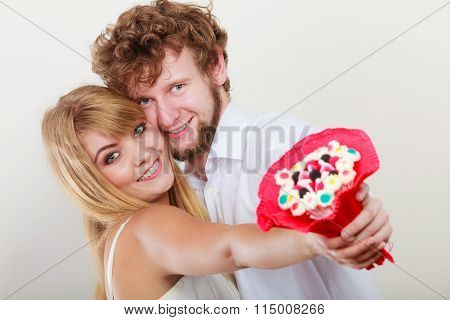 Happy Couple With Candy Bunch Flowers. Love.