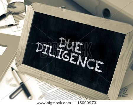 Due Diligence Handwritten on Chalkboard.