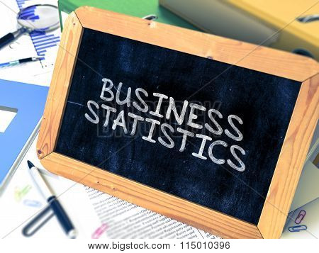 Hand Drawn Business Statistics Concept on Small Chalkboard.
