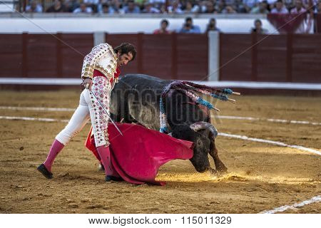 Spanish bullfighter Juan Jose Padilla bullfighting with the left hand on the pass called