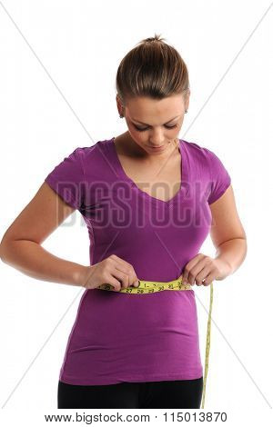 Young woman measuring waist isolated over white background