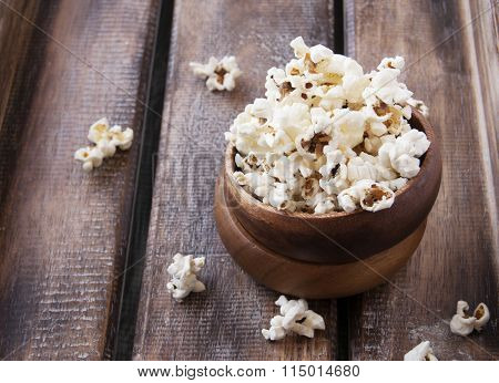 bowl of popcorn on a brown wooden table