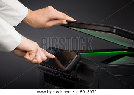 Woman Using Scanner Multifunction Device.