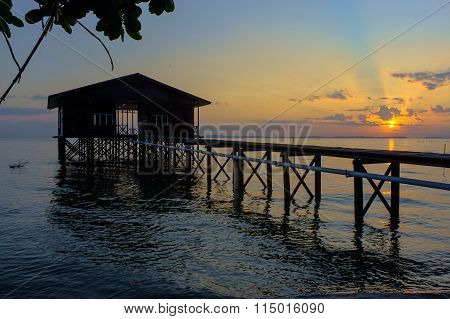 Beautiful sunrise at Kg Nagalang beach with water village house located at Labuan Malaysia.