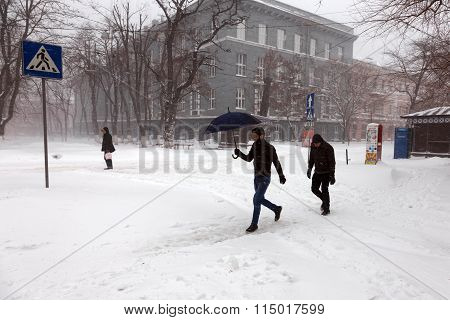 Odessa - January 18, 2016: On Snow-covered Street. People Go Along The Street During A Snowfall. Jan