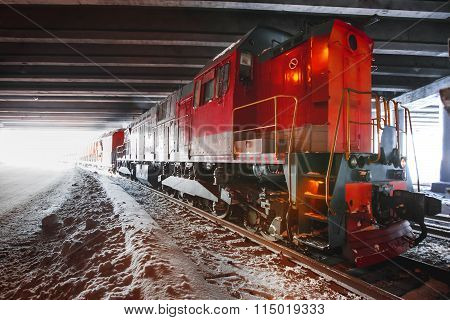 train pulling into a tunnel