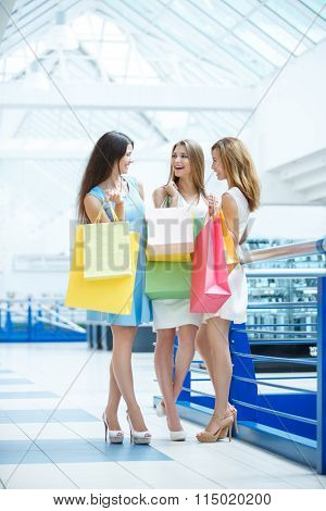 Attractive girl with shopping bag in the store
