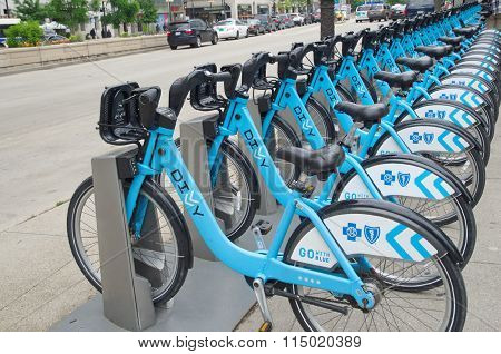 CHICAGO, IL - JUNE 11, 2015: Divvy bikes for rent in downtown Chicago near Millenium Park. The large