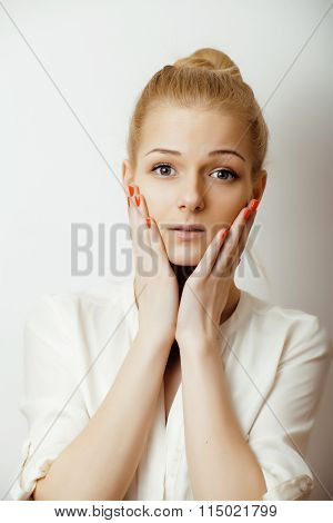 young blond woman on white backgroung gesture thumbs up, isolated emotional