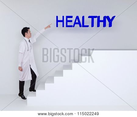 Doctor Stepping Up On Stairs And Pointing To Healthy