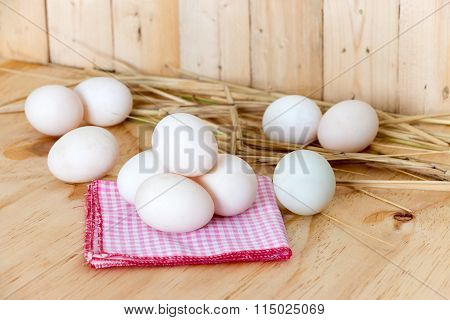 Eggs On Red Hanky On Wooden Background