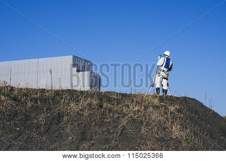 Civil Engineer Working On Construction Site