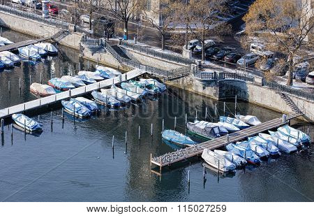 Boats at pier on the Stadhausquai quay in Zurich, Switzerland