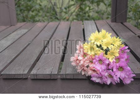 Soft Focus And Blur. Bouquet Of Colorful Flowers Placed On A Wooden Floor.