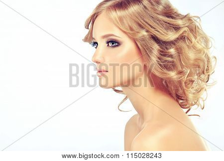 Beautiful model blonde with long curled hair