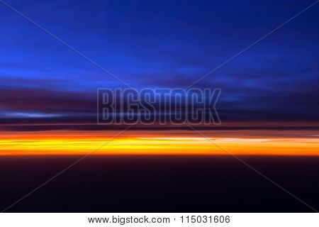 Spectacular view of horizon during sunset from airplane