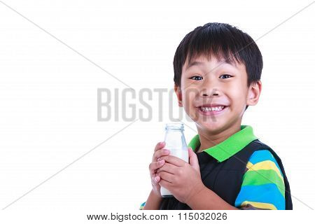 Close Up Boy Smiling And Holding Bottle Of Milk, On White.