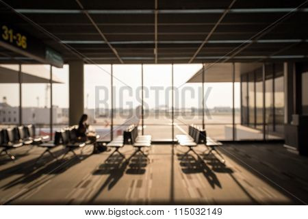 Blurred image of row of chairs at the airport