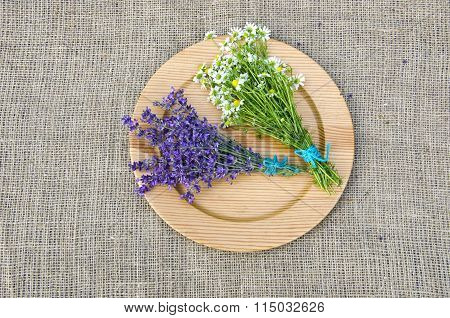 Chamomile And Hyssop On Wooden Plate