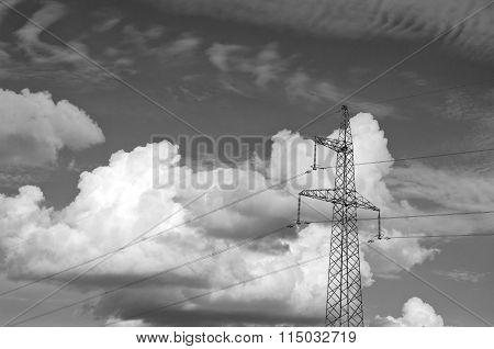 Black And White Photo Of Electrical Pylon With Dramatic Clouds