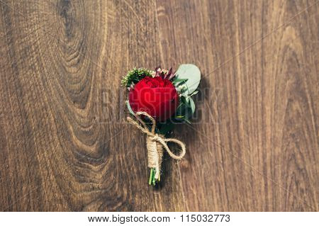 Wedding Red Rose Boutonniere On Wedding Background In Rustic Style